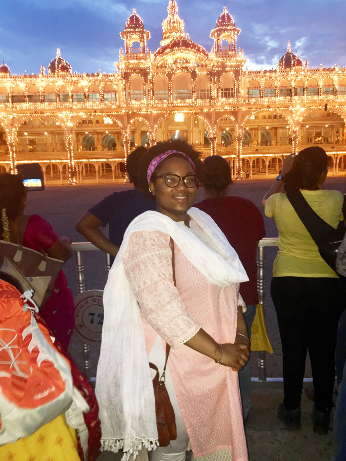 Jaelle in front of the glowing Mysore palace