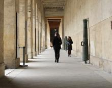 A student walks along the History Museum in Paris