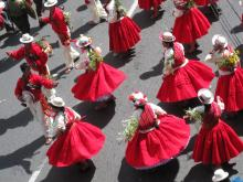 The colors of red and white shine bright in a local Peruvian festival