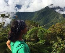 A student looks over the rainforest in Cuba
